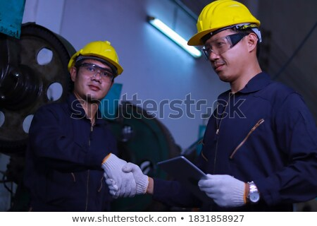 Foto stock: Two Manual Workers Greeting Each Other