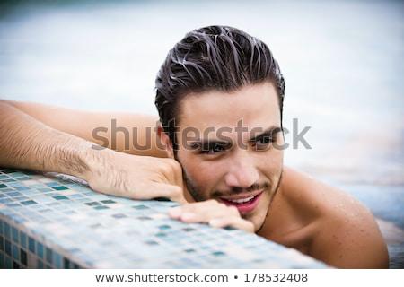 Vonzó férfi úszómedence áll víz boldog Stock fotó © wavebreak_media