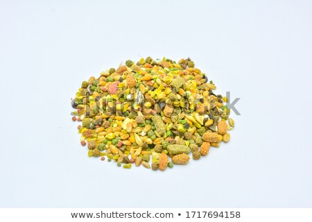 pile of bird seed including sunflower seeds wheat and maize stock photo © sarahdoow