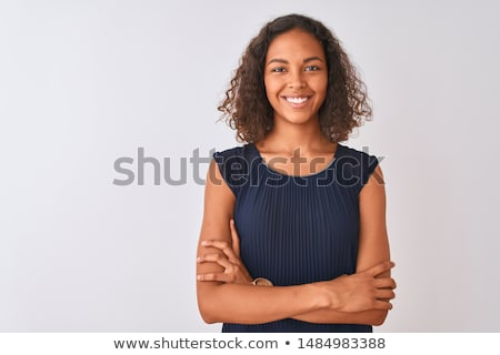 Young hispanic woman looking at camera and smiling Stock photo © diego_cervo
