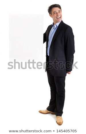 dapper businessman with blank sign stock photo © smithore