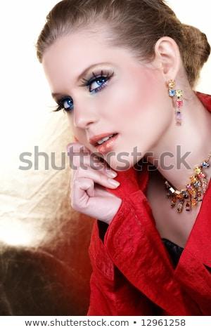 Sorridente make-up modelo extremo mão cara Foto stock © Geribody