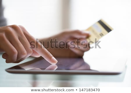 Tablet pc with a credit card Stock photo © stockyimages