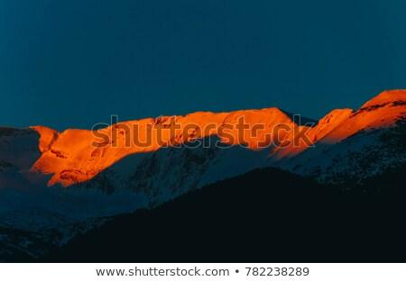 Crimson sunrise in mountains Stock photo © Nejron