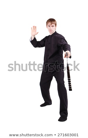 martial arts master with nunchucks on white stock photo © elnur