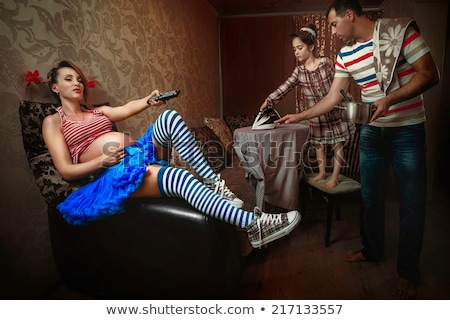 женщину рубашку Смотря телевизор железной смотрят Сток-фото © diego_cervo