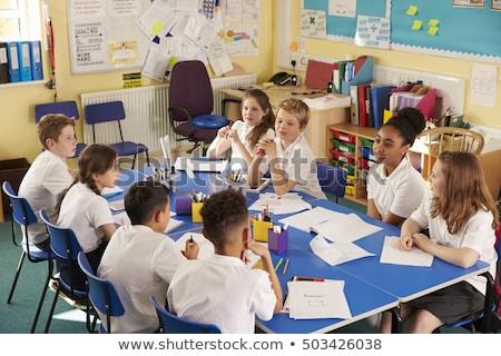 Group Of Primary Schoolchildren In Classroom Working At Desks Stock photo © monkey_business