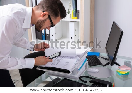 businesman stealing secret document Stock photo © dgilder