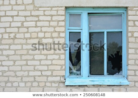 Wall of old destroyed house with broken windows Stock photo © BSANI