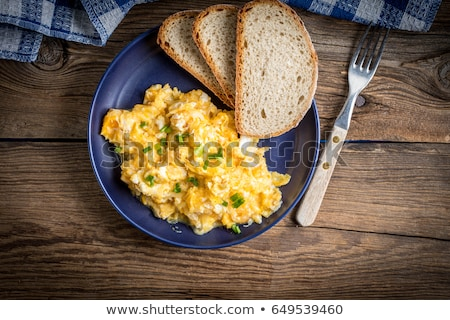 Breakfast plate serving with scrambled egg Stock photo © punsayaporn
