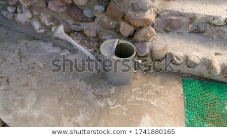 an old silver metal watering can stock photo © chrisga