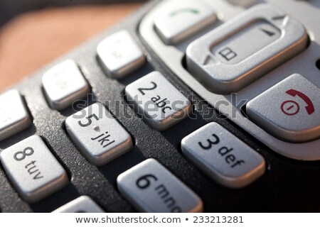 closeup of a numeric keypad in direct sunlight stock photo © giulio_fornasar