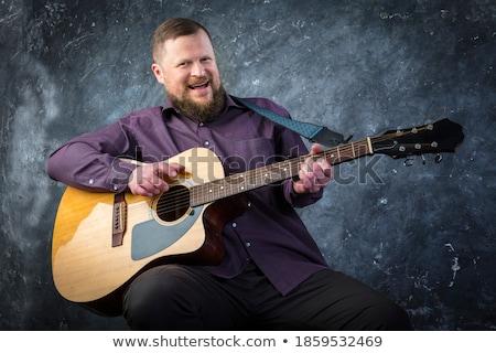 Stok fotoğraf: Erkekler · oynama · akustik · gitar · ahşap · caz · elektrik