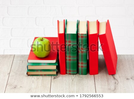 Book Stack on Desk with Chalkboard Background stock photo © frannyanne