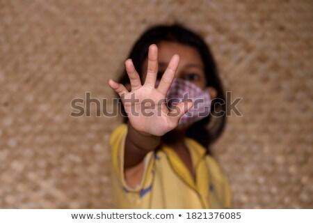 stop trafficking on open hand stock photo © tashatuvango