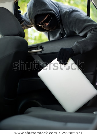 Thief Stealing Laptop Through Car Window Stock photo © AndreyPopov