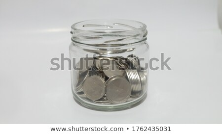 glass jar with silver coins stock photo © caimacanul