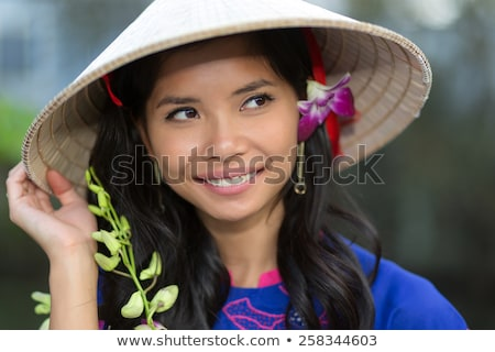 Pretty Vietnamese woman with a flower in her hair Stock photo © smithore