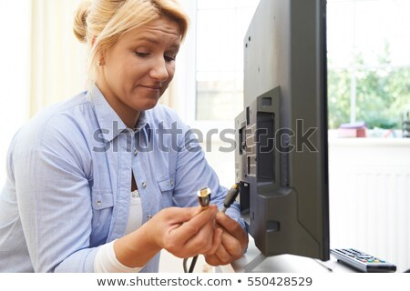 Confused Woman Unsure As to How To Put Leads Into New Television Stock photo © HighwayStarz