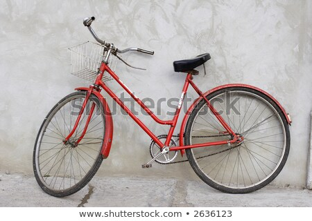 classic vintage red bicycle leaning against wall stock photo © stevanovicigor
