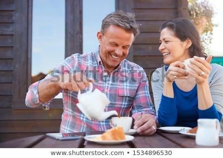 jardineiro · casal · jardim · centro · olhando - foto stock © highwaystarz