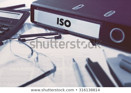 Office folder with inscription ISO. Stock photo © tashatuvango
