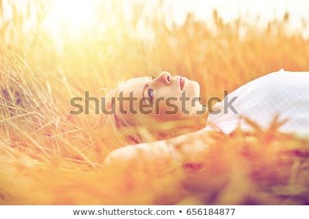 Fiatal nő álmodik megnyugtató fiatal gyönyörű nő ül Stock fotó © deandrobot