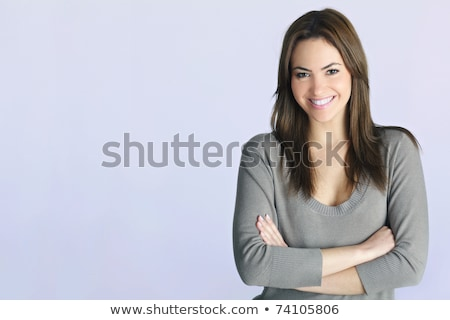 Seductive pretty young woman posing on white background Stock photo © deandrobot
