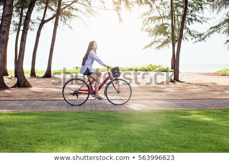 Beautiful woman with bycicle on the beach Stock photo © vlad_star