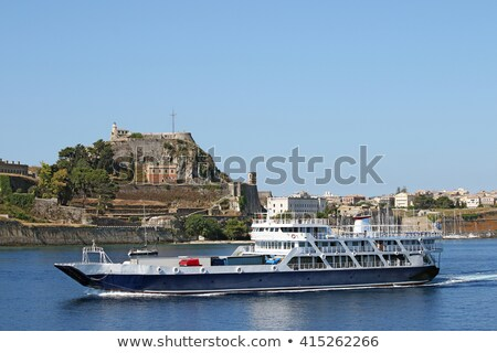 ferry boat sails close to corfu town stock photo © goce