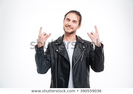 Sorridente homem bonito preto jaqueta de couro rocha gesto Foto stock © deandrobot