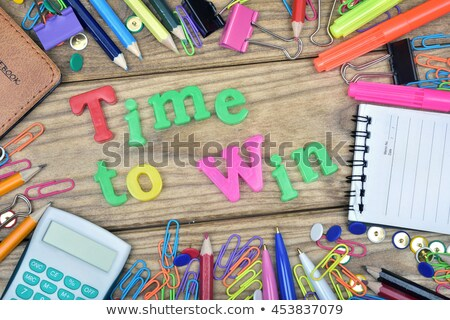 time to win word and office tools on wooden table stock photo © fuzzbones0