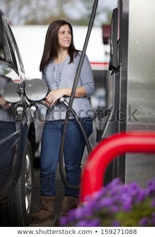 Сток-фото: женщину · бензин · автомобилей · АЗС · бизнеса · девушки