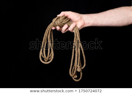 Man holding a loop of a coiled rope Stock photo © ozgur