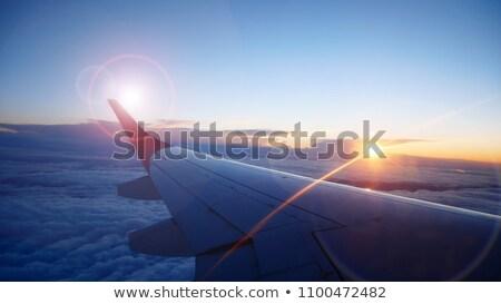 Wing seat seen through window of an aircraft Stock photo © nalinratphi