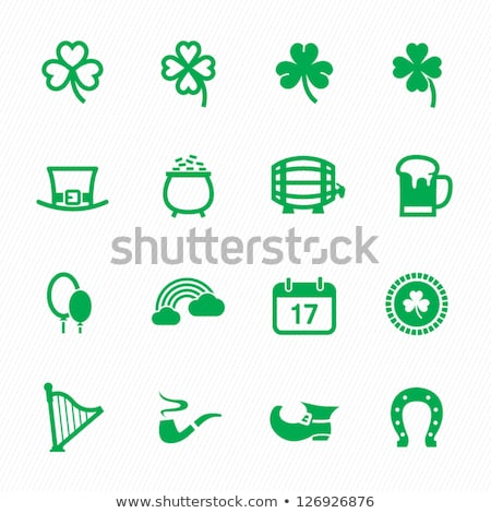 Horseshoes and clover with four leaf  Stock photo © orla
