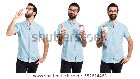 bearded young man wearing glasses drinking coffee stock photo © deandrobot