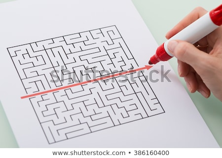 Person Drawing Straight Red Line Over Maze Stock photo © AndreyPopov