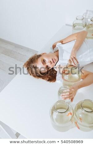 Nő fehér asztal arany halfajok érzéki Stock fotó © deandrobot
