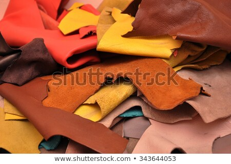 assorted pieces of skin rawhide leather pieces pieces of colored leather stock photo © andreonegin