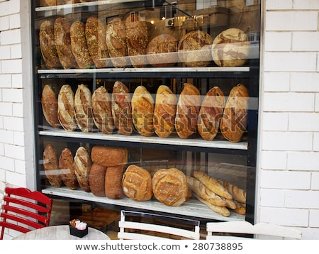 freshly baked french croissants in street bakery store stock photo © smuki