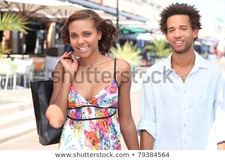 Encantador casal caminhada para baixo rua vintage Foto stock © tekso