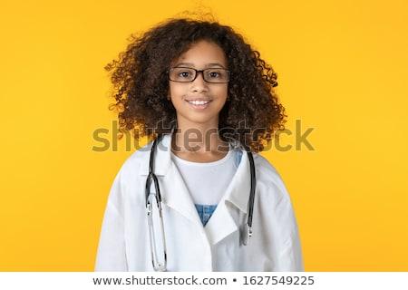 lány · orvos · jelmez · gyönyörű · kislány · mutat - stock fotó © LightFieldStudios