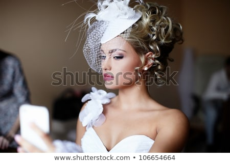 romantic photo of a blonde wearing colorful dress stock photo © konradbak