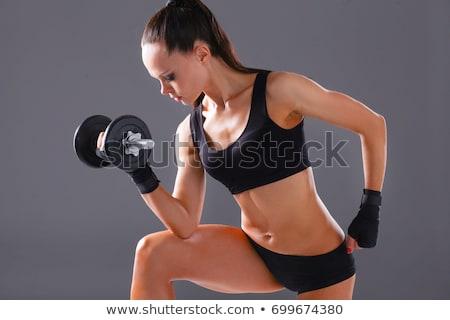 ストックフォト: アスレチック · 女性 · アップ · 筋肉 · ダンベル · 笑みを浮かべて