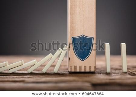 Stok fotoğraf: Kalkan · simge · düşen · domino · parçalar
