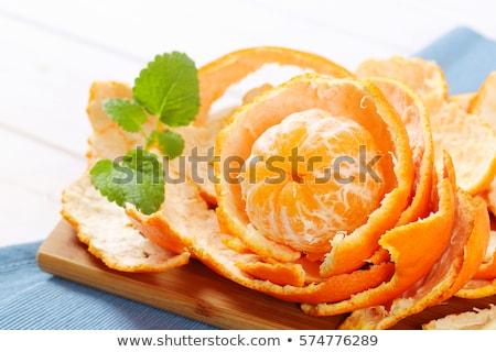 Hámozott mandarin fából készült vágódeszka közelkép étel Stock fotó © Digifoodstock