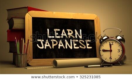 Handwritten Learn Japanese on a Chalkboard. Stock photo © tashatuvango