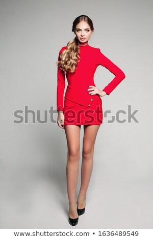 beautiful blonde girl wearing black mini dress stock photo © bartekwardziak