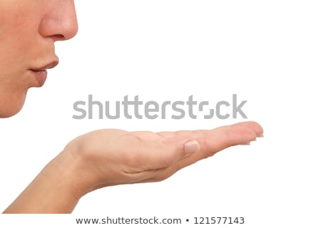 beautiful woman, cupped empty hands blowing kiss Stock photo © godfer